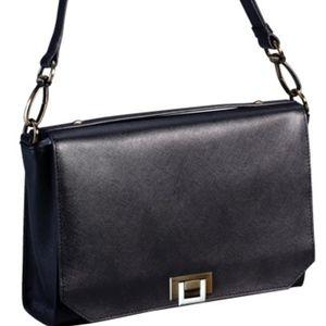 Handbag with adjustable should strap